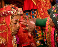 Mother Tends to Child Bride Prior to Wedding
